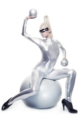 Beautiful cyber woman sitting on a silver ball