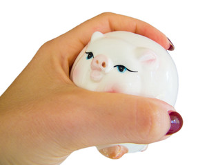 Hand with piggy moneybox