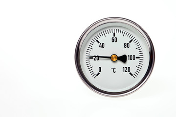A circular thermometer on a white background.