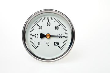 A water boiling point temperature on a circular thermometer.