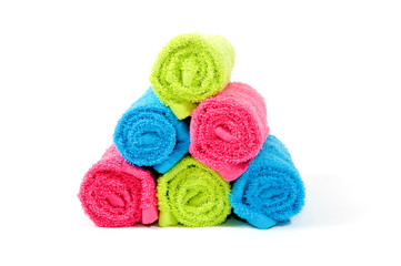 Colorful towel rolls on a white background