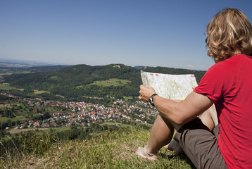 hiker takes a break - looking map
