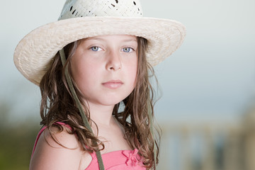 Shot of a Pretty Brown Haired child with White Hat