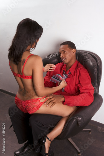 Striper woman in red seducing young black man