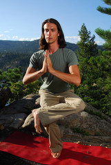 Male in yoga postion outdoors