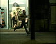 Slowmotion 35mm shot. Man running on the street at night.