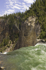 water cascading over the lower falls in Yellowstone