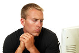 Concerned man looking at computer poster