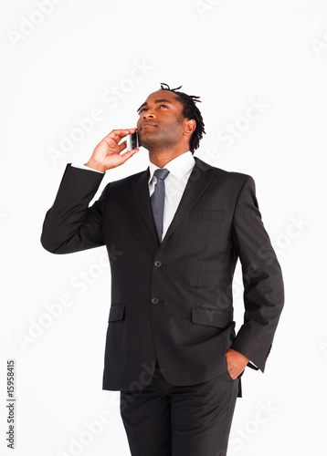 Businessman talking on the phone looking upwards