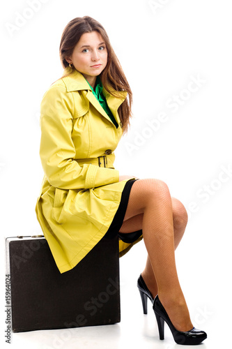 Sitting on suitcase