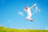 Happy young mane in white jumping on beautiful meadow poster