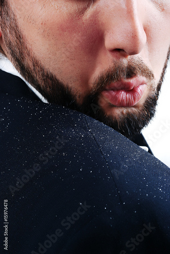 Dandruff issue on man's sholder