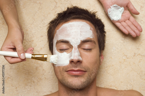 Germany, man getting a facial, close-up