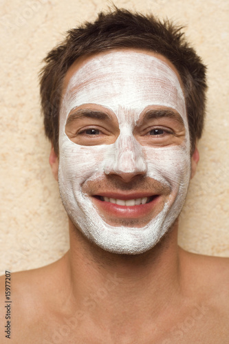 Germany, man having facial