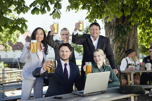 Germany, Bavaria, Upper Bavaria, Young business people in beer garden, portrait