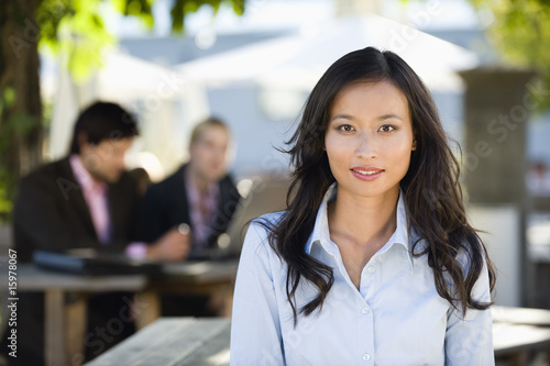 Germany, Bavaria, Upper Bavaria, Asian woman in beer garden, portrait
