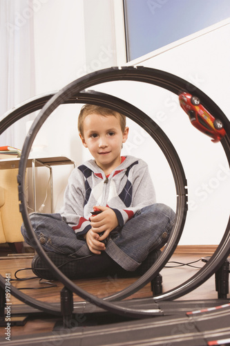 Boy (4-5) playing with toy racetrack