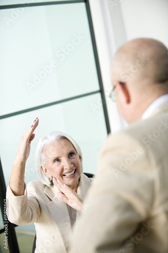 Germany, Munich, Business people during meeting, gesturing