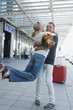 Germany, Leipzig-Halle, Airport, Couple embracing