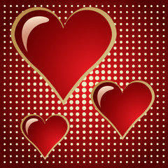three of bright red hearts on doted background