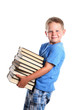 Happy child carrying books