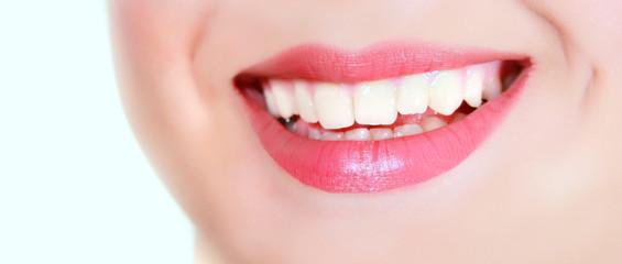 female smile over white