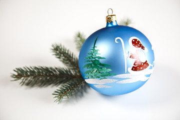 Blue Christmas bauble with ornament of Santa Claus
