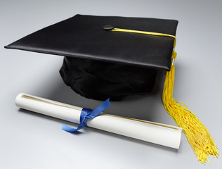 Mortar board and scroll
