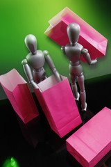 Silver dummies carrying red gift bags