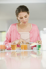 Woman having breakfast at a table