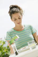 Woman seasoning salad