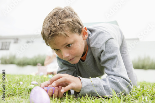 Boy looking at an Easter egg