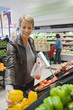 Woman buying vegetables in a supermarket