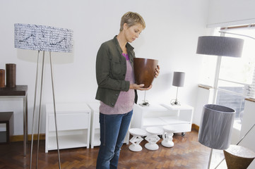 Woman holding a vase in a store