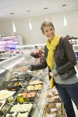Woman choosing food in a supermarket