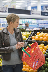 Woman buying fruits in a supermarket