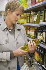 Woman buying beverages in a store