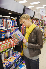 Woman choosing stationery in a supermarket