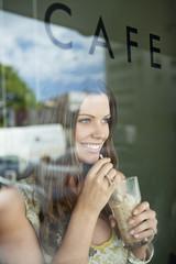 Woman drinking chocolate milkshake in a cafe