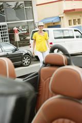 Woman walking towards a car