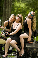 sexy group blond women on large motorcycle