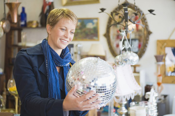 Woman holding a disco ball in a store