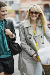Two women walking with shopping bags