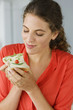 Close-up of a woman eating sandwich