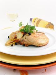 Schweinekotletts mit Kartoffeln und Weißwein