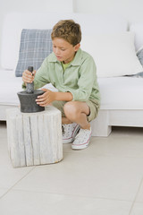 Boy using mortar and pestle