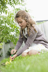 Girl gardening with a trowel
