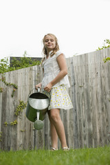 Girl holding a watering can