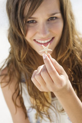 Woman showing a starfish and smiling