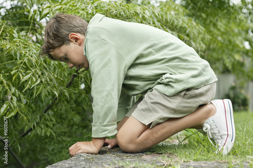 Boy playing in a garden